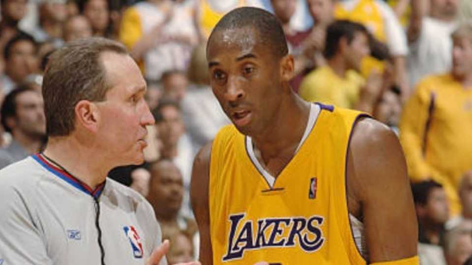 Retired veteran NBA official Joe DeRosa and Kobe Bryant