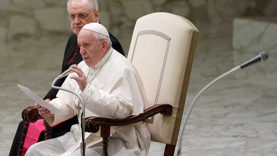 Pope Francis reads his message during the weekly general audience at the Vatican, Wednesday, Feb. 12, 2020.