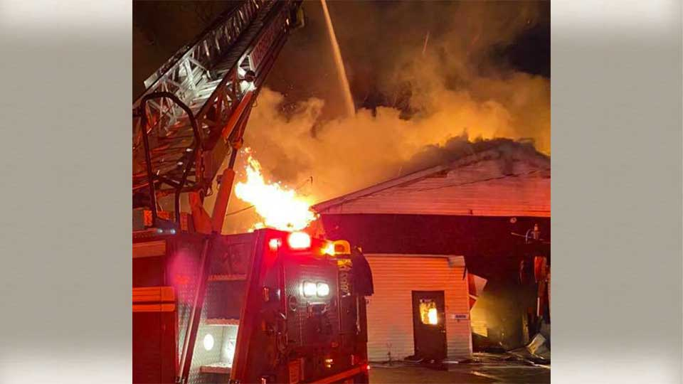 Crews worked early Tuesday to put out a fire at an auto body shop in Warren.