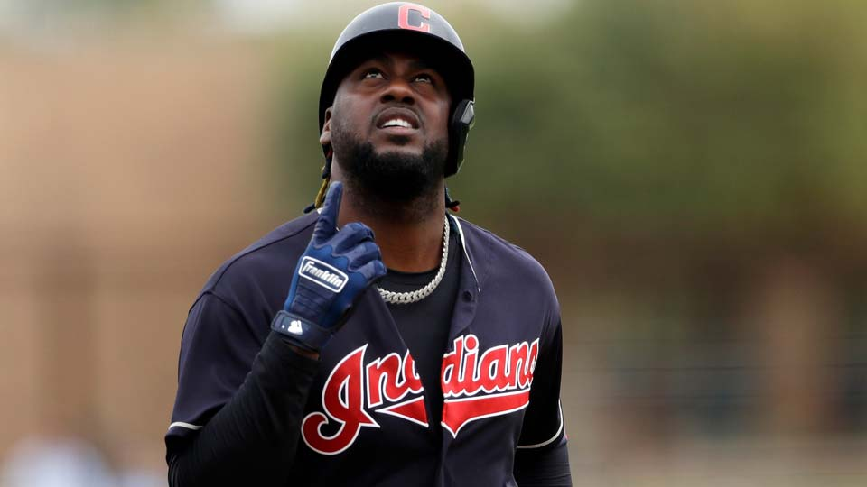 leveland Indians' Franmil Reyes points skyward after hitting a home run