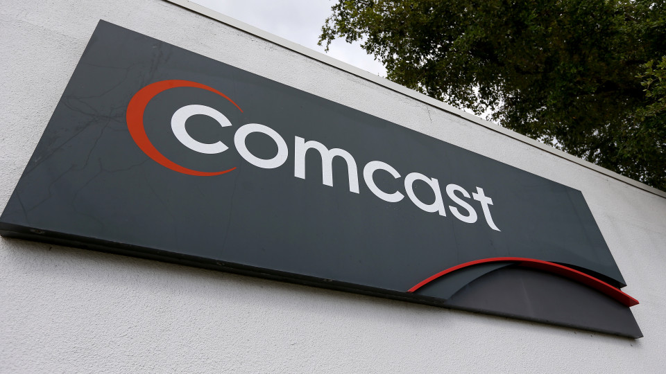 POMPANO BEACH, FL - FEBRUARY 13: A Comcast sign is seen at one of their centers on February 13, 2014 in Pompano Beach, Florida. Today, Comcast announced a $45-billion offer for Time Warner Cable.