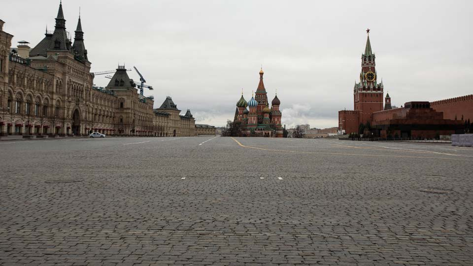 A view of an empty Red square, with the St. Basil's Cathedral, center, and Kremlin's Spasskaya Tower, right, in Moscow, Russia