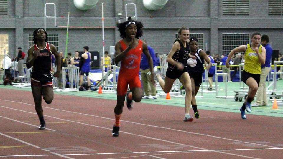 Bloomfield High School transgender athlete Terry Miller, second from left, wins the final of the 55-meter dash over transgender athlete Andraya Yearwood