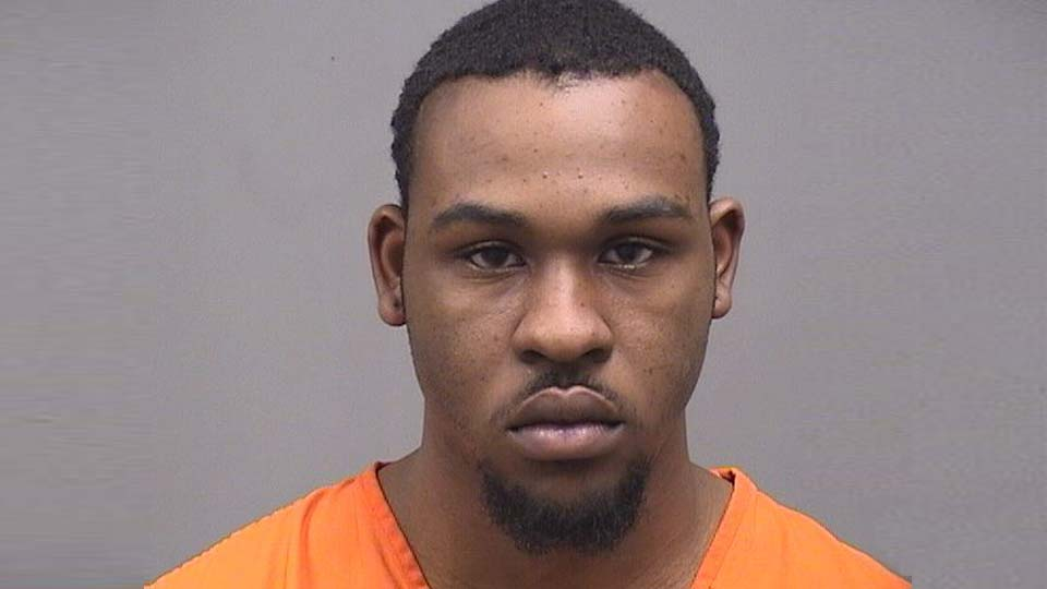 Michael Johnson, charged with resisting arrest and impropering handling a firearm in Youngstown