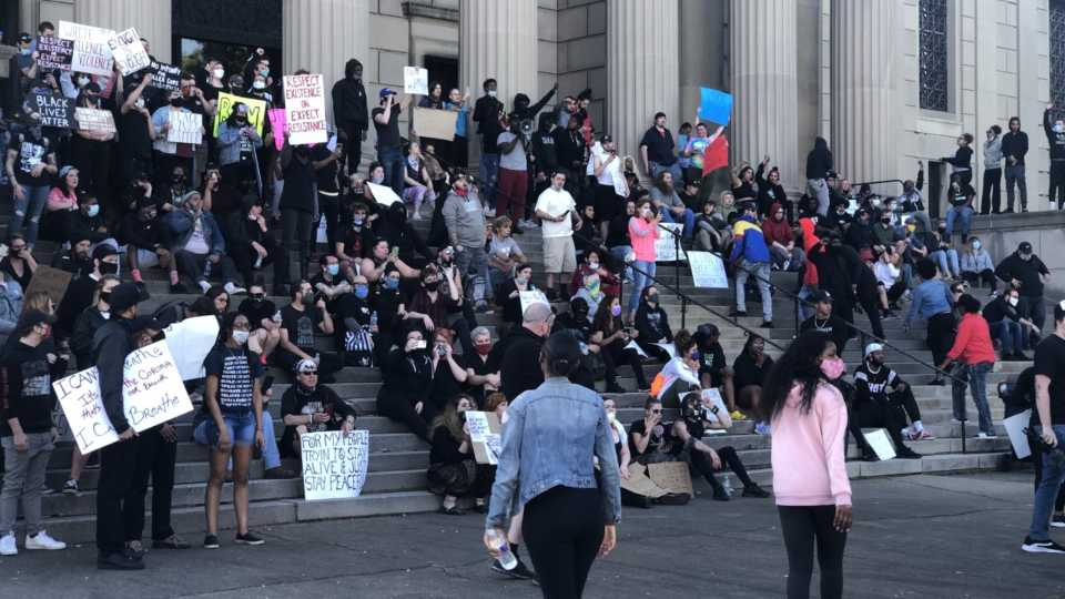 Crowds at Stambaugh Auditorium protest