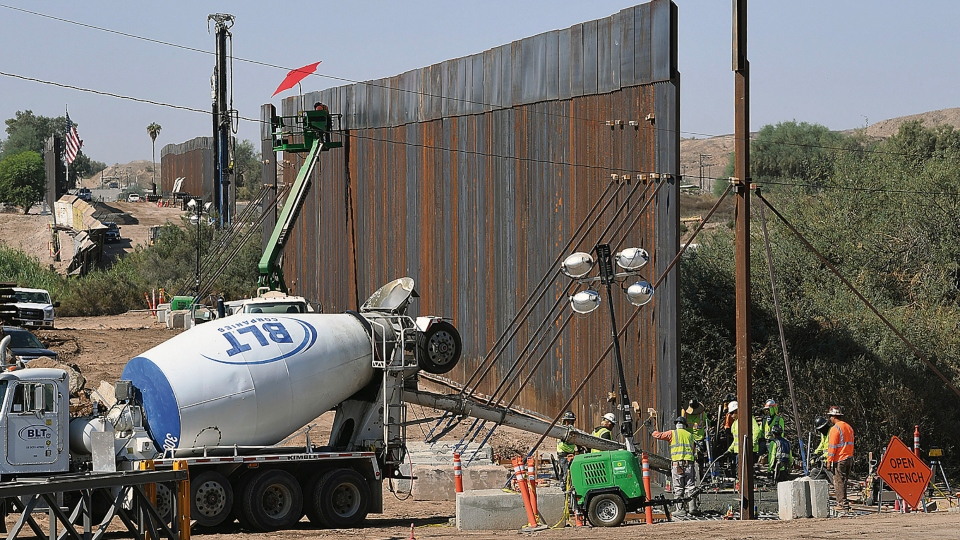 "More sections of the 30-foot high ""bollard style wall"" between the United States and Mexico are seen being constructed heading west from the Yuma Levee Road, in the proximity of County 8th Street, in the direction of the Colorado River, Thursday, Oct. 15, 2020 in Yuma, Ariz"