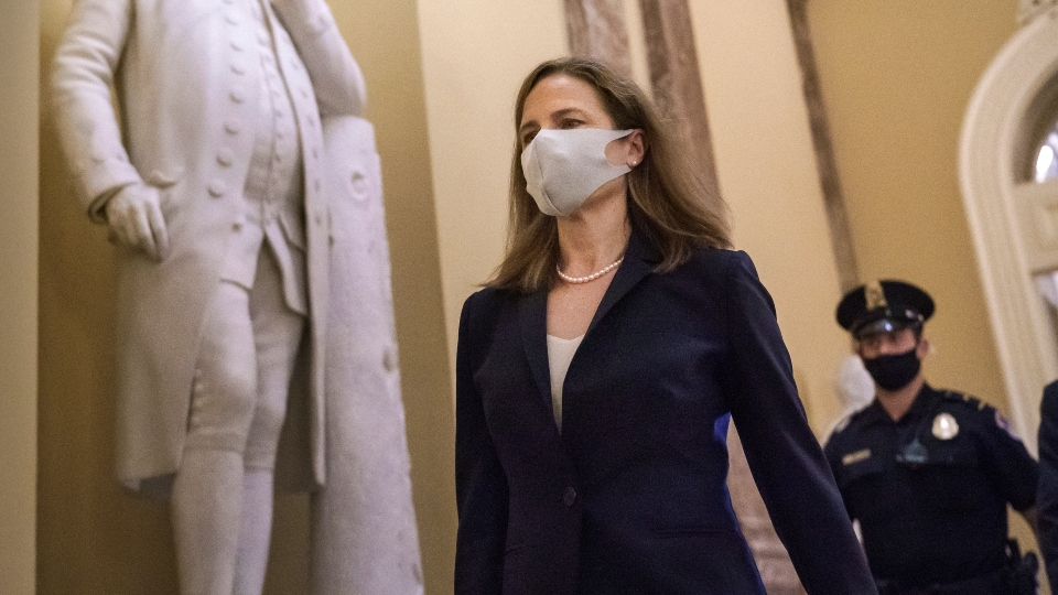 Judge Amy Coney Barrett, President Donald Trump's nominee for the Supreme Court, arrives for closed meetings with senators, at the Capitol in Washington, Wednesday, Oct. 21, 2020.