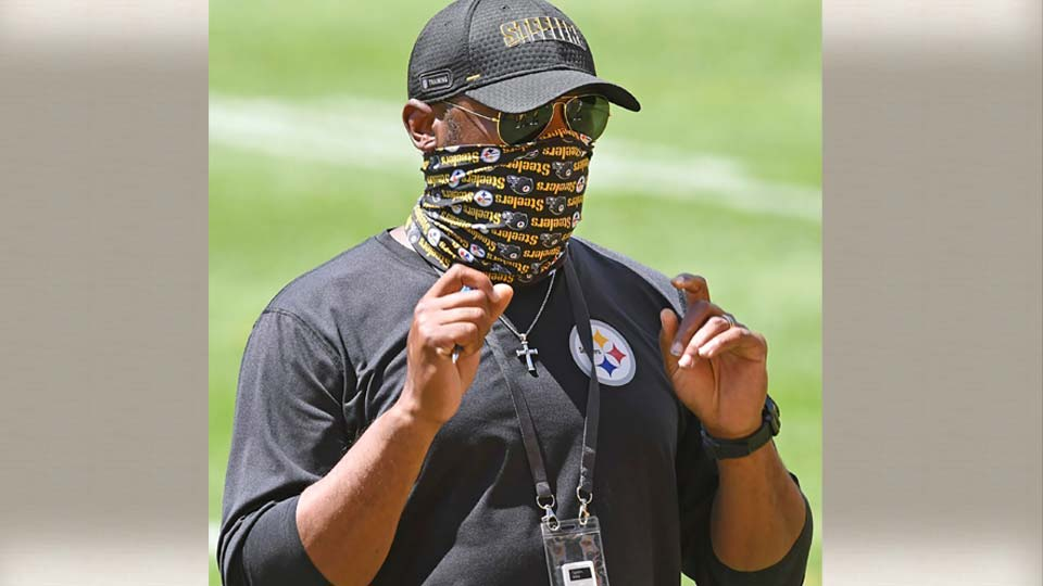 In this Aug. 17, 2020, file photo, Pittsburgh Steelers head coach Mike Tomlin looks on during practice at Heinz Field in Pittsburgh.