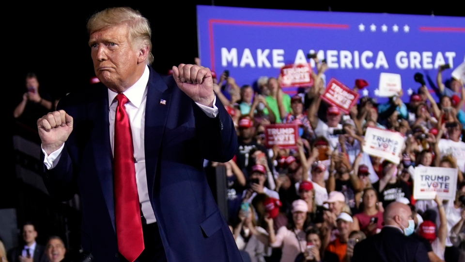 President Donald Trump dances after a campaign rally at Pensacola International Airport, Friday, Oct. 23, 2020, in Pensacola, Fla.