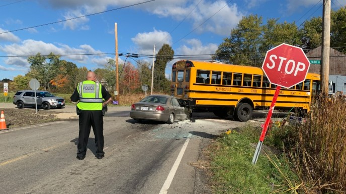 Car catches fire after slamming into Weathersfield school bus