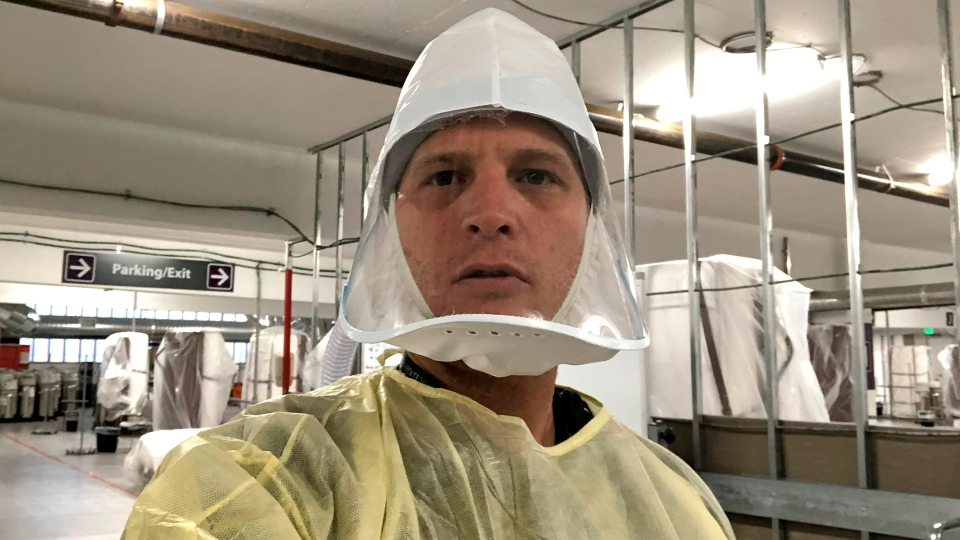 FILE - This Nov. 12, 2020 selfie photo provided by the Renown Regional Medical Center shows Dr. Jacob Keeperman, the Renown Transfer and Operations Center medical director who made the photo on the opening day of the Renown Regional Medical Center's alternative care site located in a parking garage. On Friday, Dec. 4, 2020, The Associated Press reported on stories circulating online incorrectly asserting this photo at an auxiliary care site for COVID-19 patients proves that the coronavirus pandemic is a hoax. The photo, which shows empty hospital beds, was taken the day the site was opened, and patients had yet to arrive.