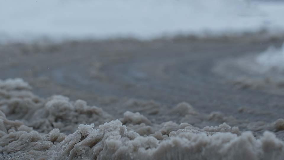 Slushy snow on a road.