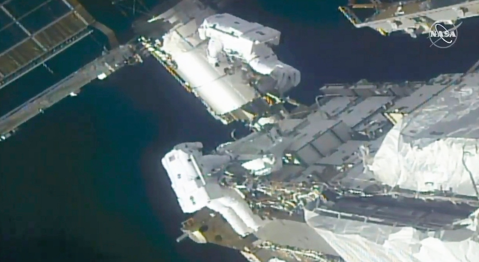 spacewalking astronauts solar panels