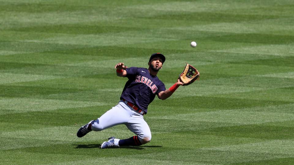 Cleveland Indians' Eddie Rosario fields the ball during a baseball game against the Cincinnati Reds in Cincinnati, Sunday, April 18, 2021. The Indians won 6-3.