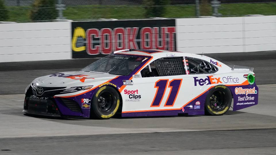 Denny Hamlin (11) leads the field in Turn 2 prior to a rain delay in the NASCAR Cup Series auto race at Martinsville Speedway in Martinsville, Va., Saturday, April 10, 2021.