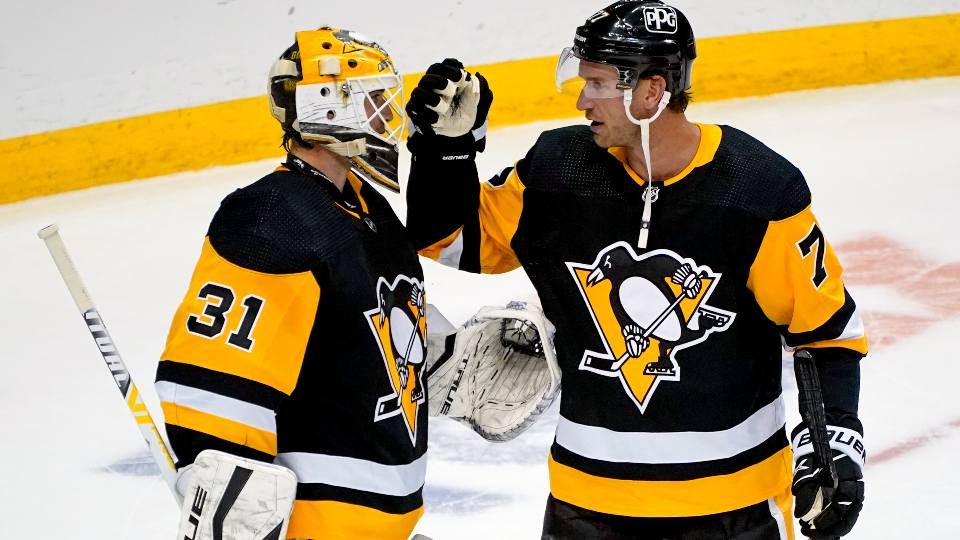Pittsburgh Penguins goaltender Maxime Lagace (31) celebrates his first career shutout with Jeff Carter after an NHL hockey game against the Buffalo Sabres in Pittsburgh, Saturday, May 8, 2021. The Penguins won 1-0.