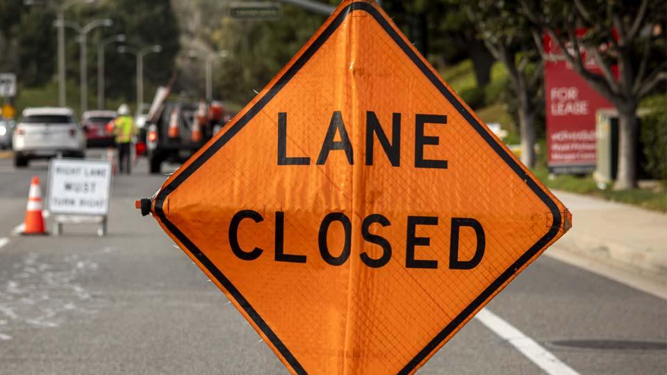 Lane Closed orange diamond shaped sign
