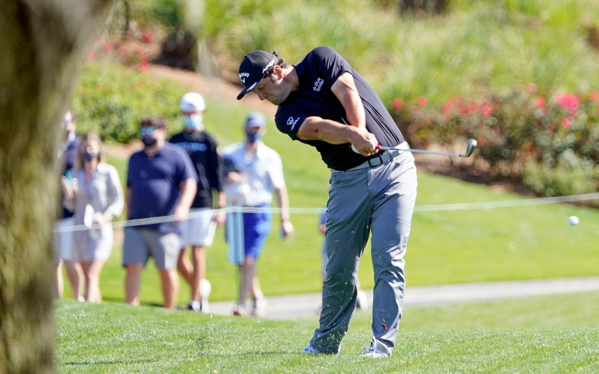 Jon Rahm of Spain, hits a shot on the 18th fairway during a practice round at the The Players Championship golf tournament Wednesday, March 10, 2021, in Ponte Vedra Beach, Fla. (AP Photo/John Raoux)