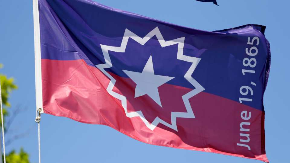 The Juneteenth flag, commemorating the day that slavery ended in the U.S., flies in Omaha, Neb., Wednesday, June 17, 2020.