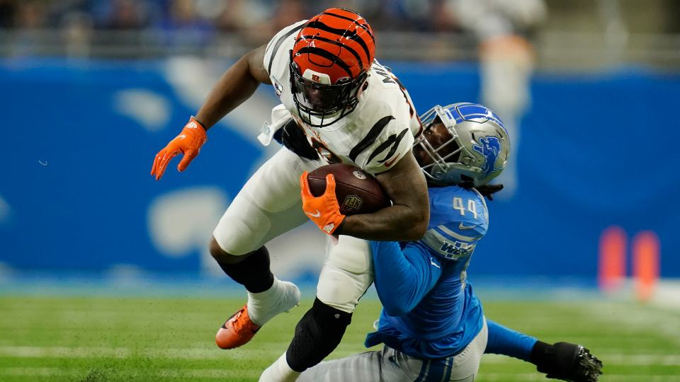 Cincinnati Bengals running back Joe Mixon is tackled by Detroit Lions linebacker Jalen Reeves-Maybin (44) during the first half of an NFL football game, Sunday, Oct. 17, 2021, in Detroit. (AP Photo/Paul Sancya)