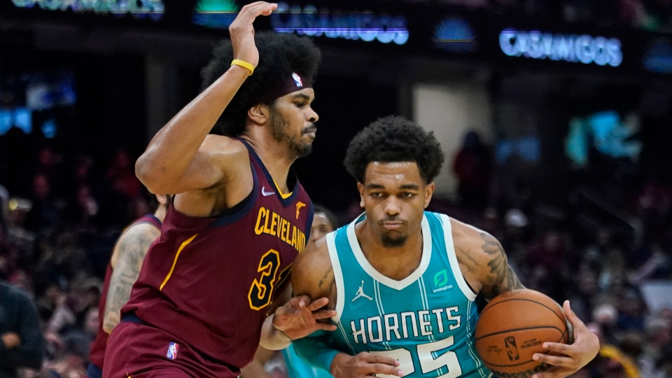 Charlotte Hornets' P.J. Washington (25) drives against Cleveland Cavaliers' Jarrett Allen (31) during the second half of an NBA basketball game Friday, Oct. 22, 2021, in Cleveland. Charlotte won 123-112.