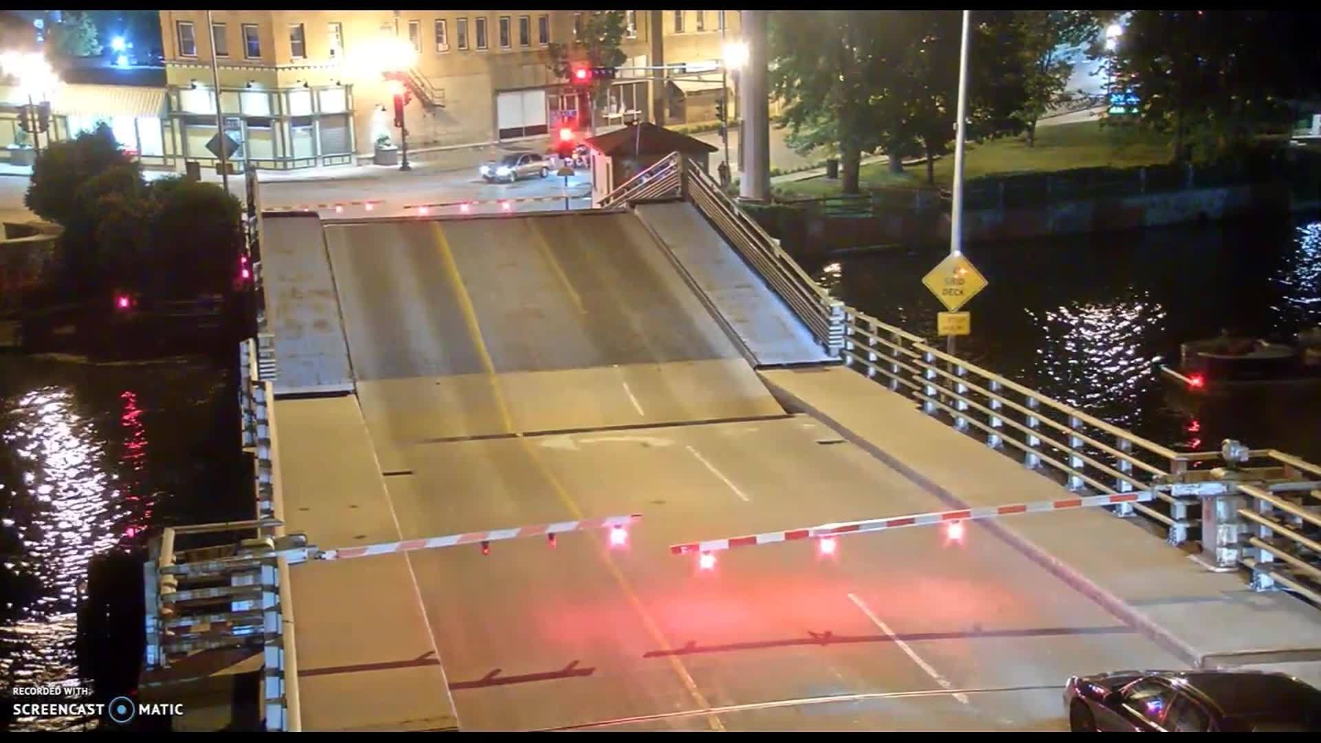 Bicyclist falls into drawbridge