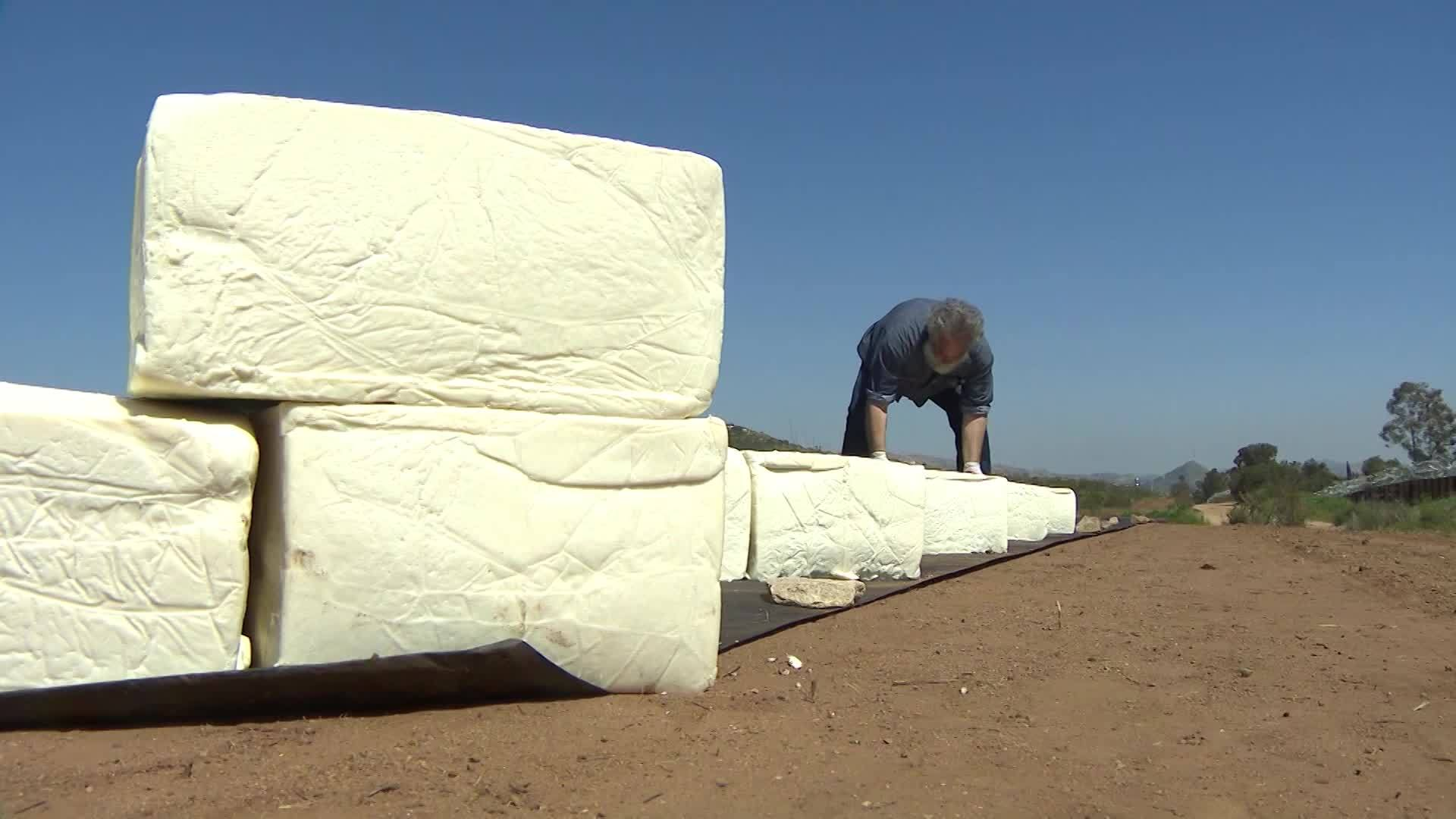VIDEO: Artist building giant cheese wall along US-Mexico border