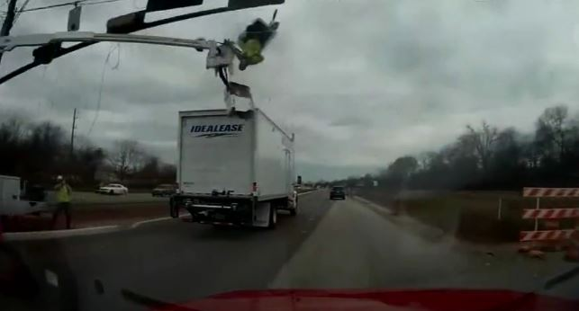 WATCH: Truck crash sends worker flying out of construction bucket