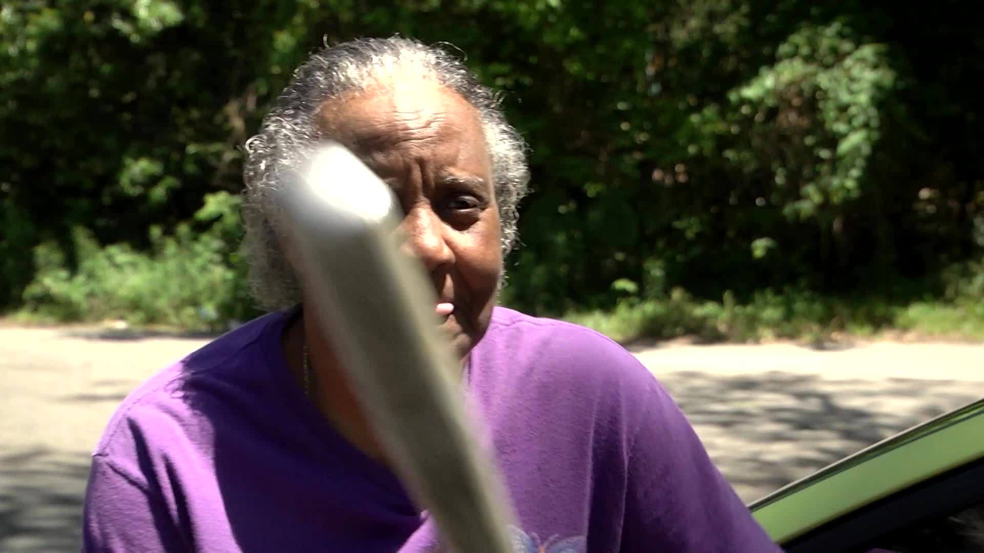 Grandma fights off have naked burglary suspect with bat