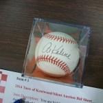 Up for auction, a baseball signed by former Detroit Tiger Al Kaline.