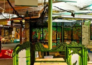 The club created a jungle-themed mural at the Grand Rapids Children's Museum.