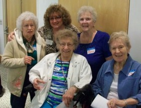 "Susan Lamos, life engagement director at Vista Springs Living Center (back center) takes these resident volunteers to read to three- and four-year olds. She says it makes their day when they here the kids say, ""The grandmas are here to read to us!"""