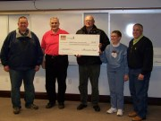 Edward Mau (center) donated $2500 from Monsanto to the Starke County Humane Society.