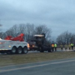 This semi is hauled from the scene after fire crews put out a fire that erupted after an accident.