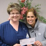 Kelly Ortman (left), RN, Director of Oncology and Medical-Surgical at Pulaski Memorial Hospital presents a check for $350 to Christina Pugh.