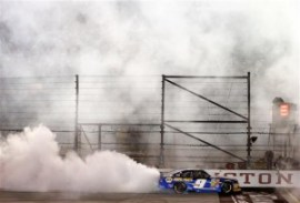 Chase Elliott, driver of the #9 NAPA Auto Parts Chevrolet, celebrates with a burnout after winning the NASCAR Nationwide Series VFW Sport Clips Help A Hero 200 at Darlington Raceway on April 11, 2014 in Darlington, South Carolina. Photo by Getty Images