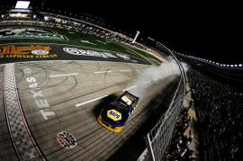 Chase Elliott, driver of the #9 NAPA Auto Parts Chevrolet, celebrates with a burnout after winning the NASCAR Nationwide Series O'Reilly Auto Parts 300 at Texas Motor Speedway on April 4, 2014 in Fort Worth, Texas. Photo by Jared C. Tilton/Getty Images