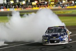 Jimmie Johnson, driver of the #48 Lowe's Patriotic Chevrolet, celebrates with a burnout after winning the NASCAR Sprint Cup Series Coca-Cola 600 at Charlotte Motor Speedway on May 25, 2014 in Charlotte, North Carolina. Photo by Matt Sullivan/Getty Images