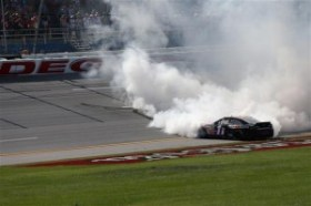 Denny Hamlin, driver of the #11 FedEx Express Toyota, celebrates with a burnout after winning the NASCAR Sprint Cup Series Aaron's 499 at Talladega Superspeedway on May 4, 2014 in Talladega, Alabama. Photo by Getty Images
