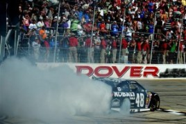 Jimmie Johnson, driver of the #48 Lowe's/Kobalt Tools Chevrolet, celebrates with a burnout after winning the NASCAR Sprint Cup Series FedEx 400 Benefiting Autism Speaks at Dover International Speedway on June 1, 2014 in Dover, Delaware. Photo by Rainier Ehrhardt/Getty Image