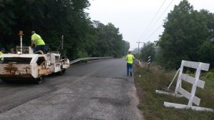 Starke County Highway Department employees paved the new bridge earlier this week.