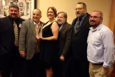 WKVI Sales Manager Tony Ross, Morning Show Host Tom Berg, News Director Mary Perren, General Manager Jerry Curtis, Operations Manager/Program Director Lenny Dessauer and Sports Director Nathan Welter are all smiles after accepting the Indiana Broadcasters Association Spectrum Award for Market 3 Station of the Year.