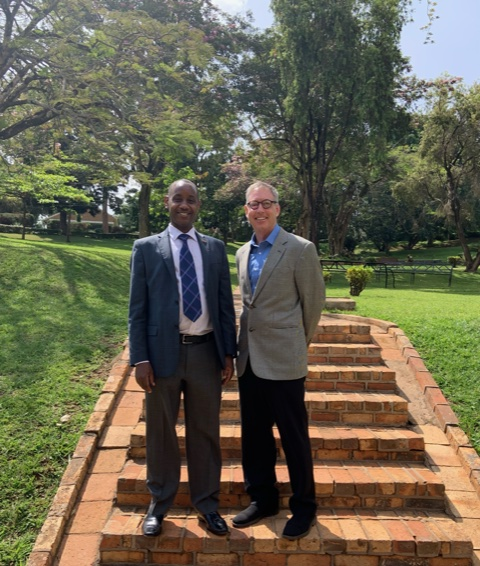 Aaron Mushengyezi, Vice Chancellor of UCU, with Tom Deans. They share an affiliation with the University of Connecticut, where Deans is a professor and Mushengyezi earned his PhD in English.
