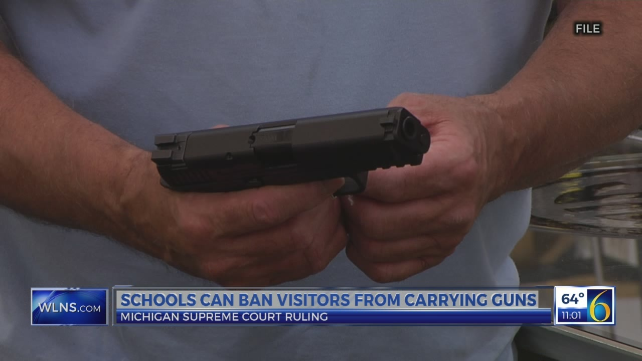 Schools can ban visitors from carrying guns