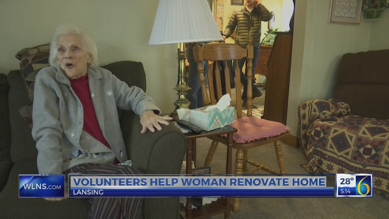 Volunteers help woman renovate home