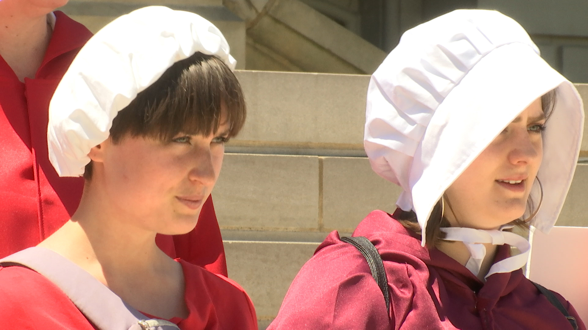 Women dress as handmaids, protest recent abortion ban laws
