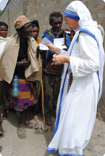 Sister Jan Maria, a Missionary of Charity Sister, giving medical support to an elderly man from a remote community in Ethiopia