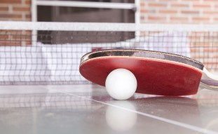 ping pong ball, bat and table