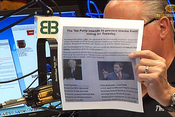 Rush Limbaugh holds up a flyer used by the Republican Party to impugn tea-party Republican Chris McDaniel.