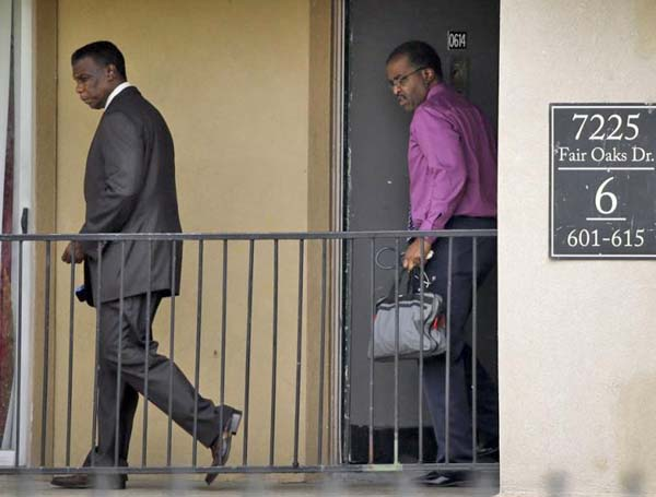 Dallas health officials leave home of quarantined family